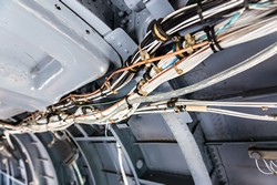 Integrated sensor system monitors aircraft wiring